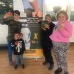 Children enjoying their fruit at their free fruit and healthy food at the Fit 4 Future Foundation Holiday Activities Camp