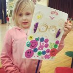 Young girl holding her painting at the Fit 4 Future Foundation Holiday Activities Camp