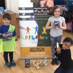 Three children holding their Easter Eggs at the Fit 4 Future Foundation Easter Holiday Activities Camp