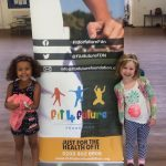 Two young girls enjoying their time at Fit 4 Future Foundation School Holiday Activities Camp