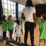 Children playing team dodgeball game at the Fit 4 Future Foundation Holiday Activities Camp