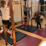 Children enjoying climbing ropes during gymnastics at the Fit 4 Future Foundation Holiday Activities Camp