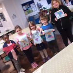 Children showing their artwork they created during Arts and Crafts at the Fit 4 Future Foundation School Holiday Activities Camp