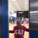 Ezra Okusanya staring through the door at the Fit 4 Future Foundation School Holiday Activities Camp