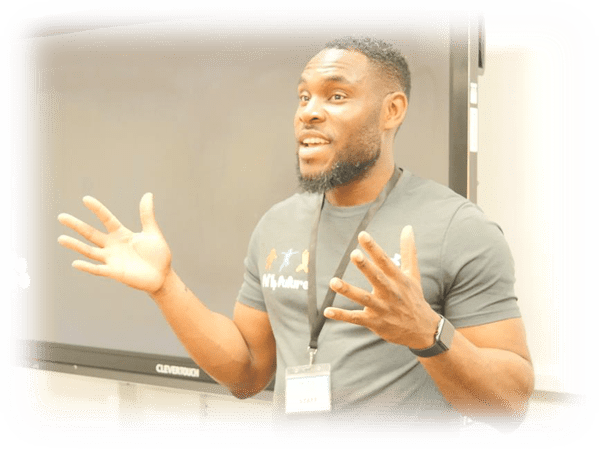 Segun Adeniji giving a motivational talk in a classroom at Lambeth Academy