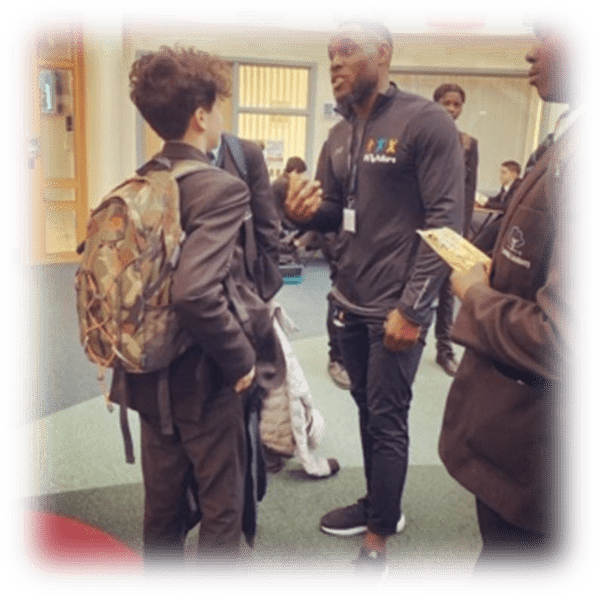 Fit 4 Future Foundation Motivational Speaker, Segun Adeniji, talking to Laith Maghary after a motivational talk to the Year 8 and 9 boys at Lambeth Academy